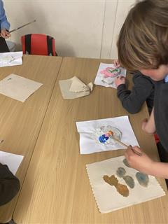 Painting our clay masks!